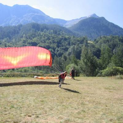 Paragliding learning to fly course in the Alps