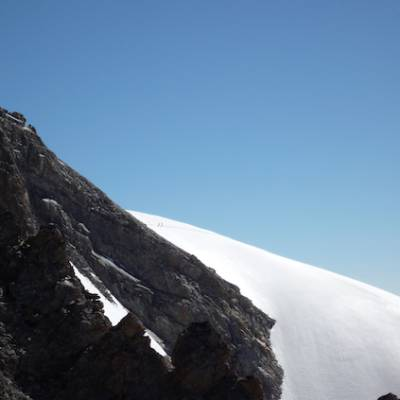 Mountaineering view of small climbers big mountain