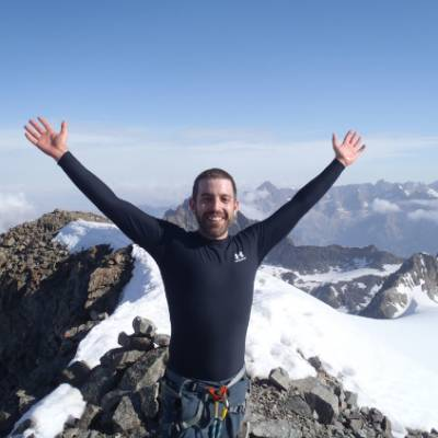 Mountaineering on the summit of Les Rouies hands i