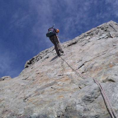 Mountaineering abseiling off