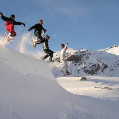 Snowshoeing jumping the cornice