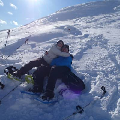 Snowshoeing couple in the snow