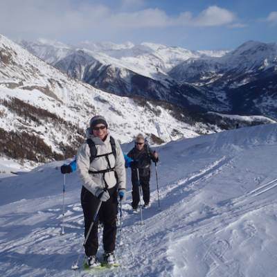 Snowshoeing arriving at the top of La Palastre