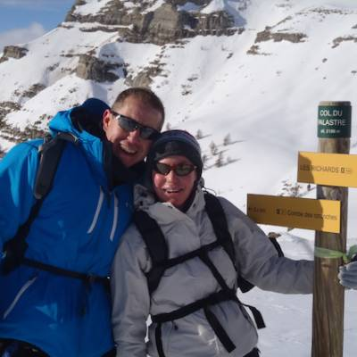 Snowshoeing couple at the col