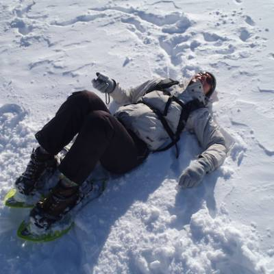 Snowshoeing resting in the snow