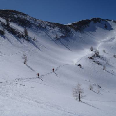 Snowshoeing descending snowfield