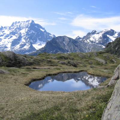 walking in the French Alps high mountain tarn