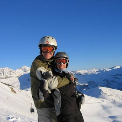 Skiing and snowboarding couple