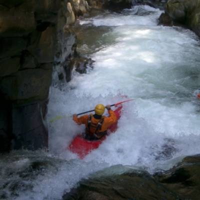 Kayaking white water rapids red kayak