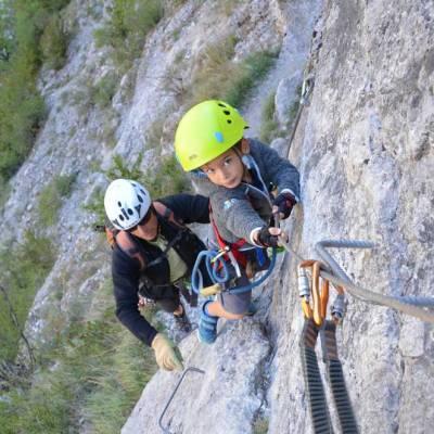 child-doing-via-ferrata-on-a-summer-activity-holiday-in-Alps.jpg